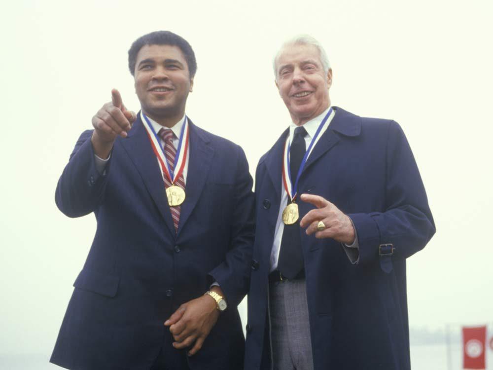 Joe DiMaggio with Muhammad Ali
