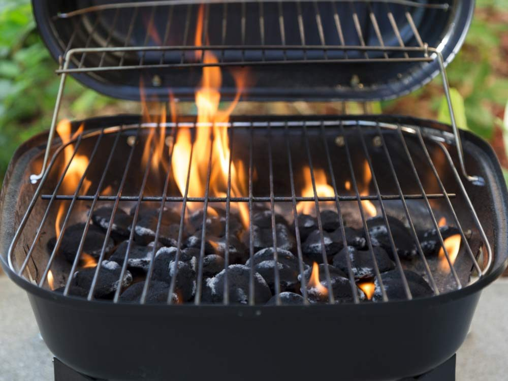 Close-up of charcoal grill and flames