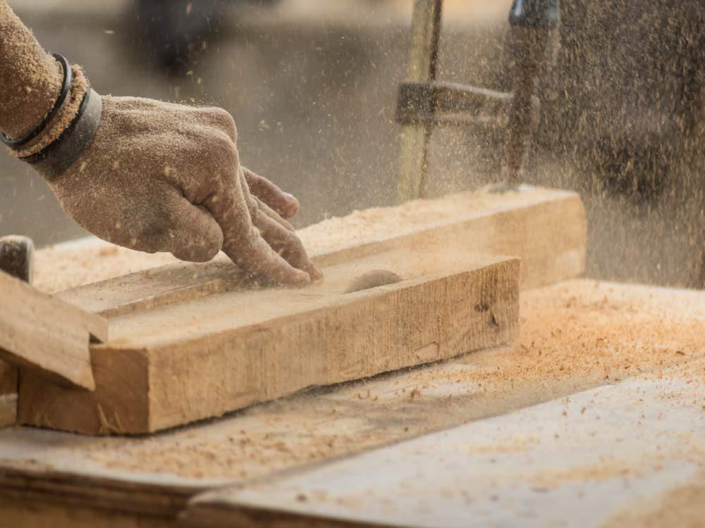 Carpenter processing wood