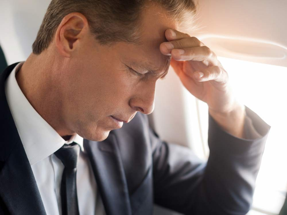 Stressed out man on flight