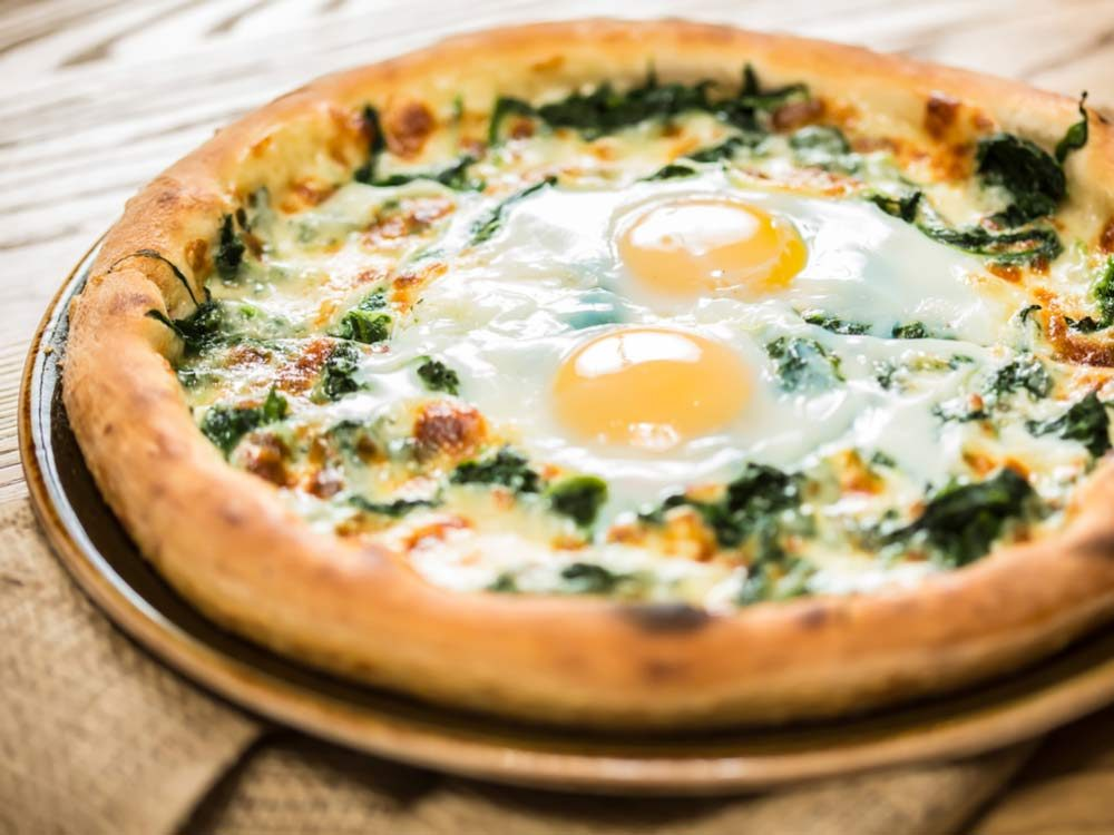 Sunny side up eggs on pizza