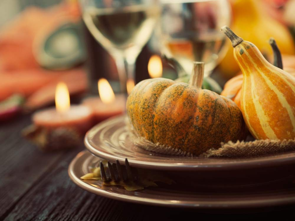 Autumn table settings with pumpkins