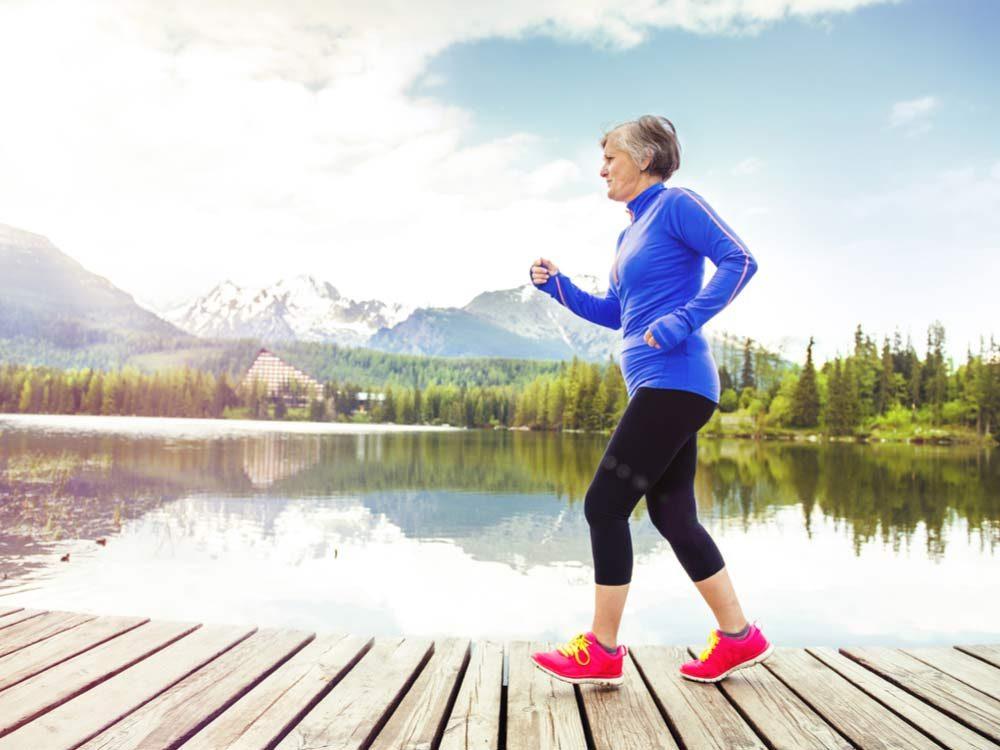 Senior woman running on dock