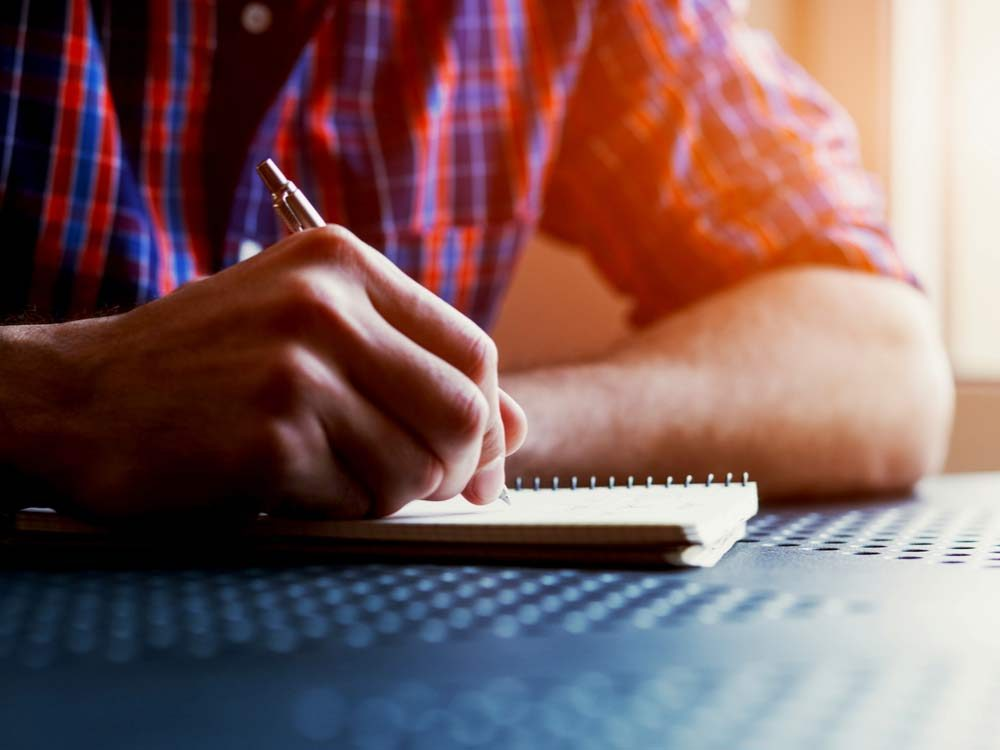 Man writing in his notebook