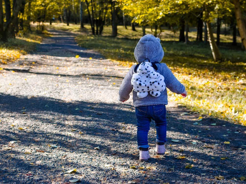 Little girl wearing plush backpack