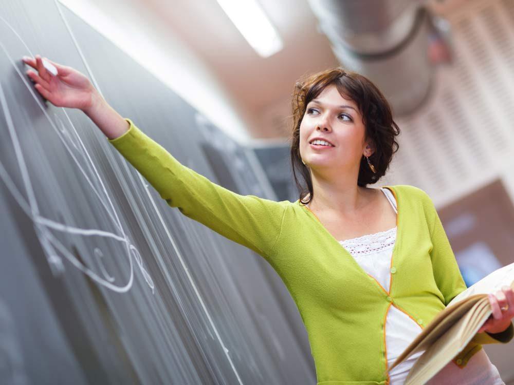Female teacher in math class