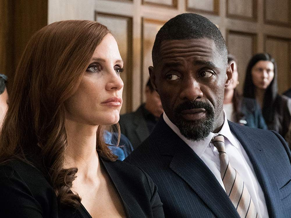 """Jessica Chastain and Idris Elba in """"Molly's Game"""""""