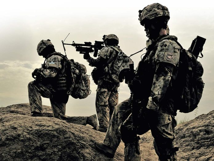 Canadian soldiers armed in Afghanistan