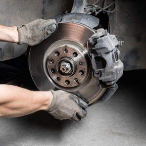 Mechanic checking brakes