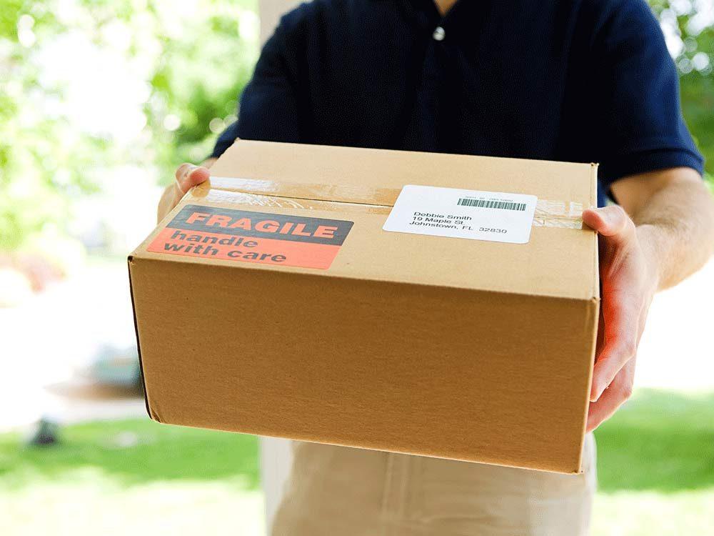 Mailman delivering package