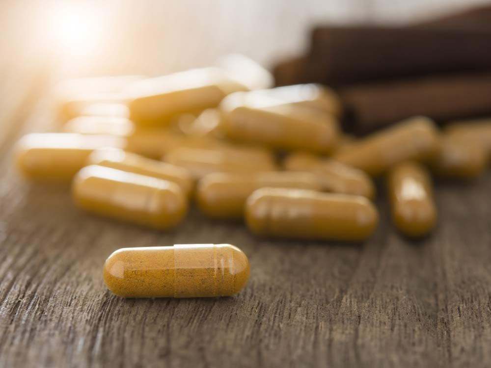 Herbal supplements on wooden table
