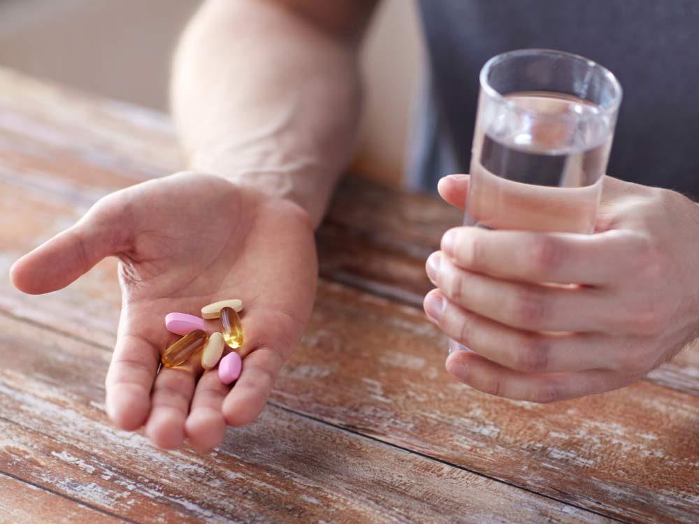 Man taking vitamins