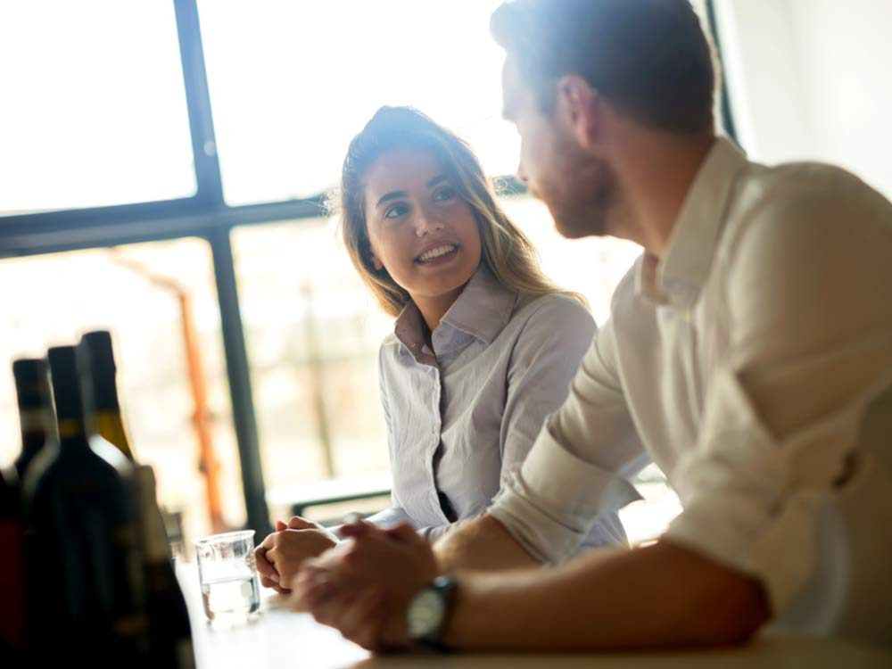 Business people formally dressed flirting in cafe