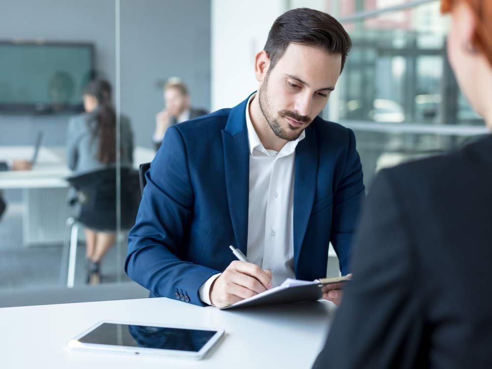 Man filling out job interview questionnaire