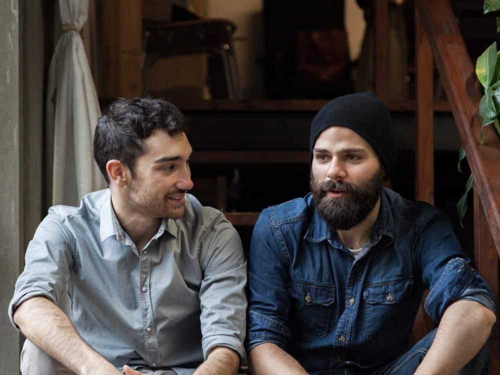 Two male friends talking
