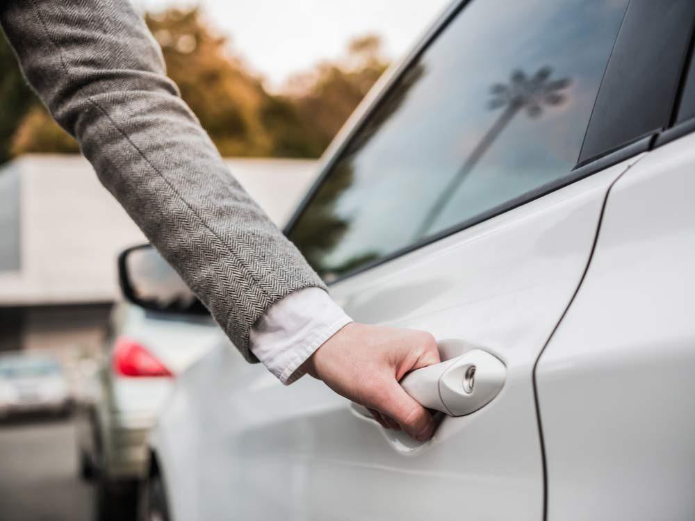 Woman opening car door
