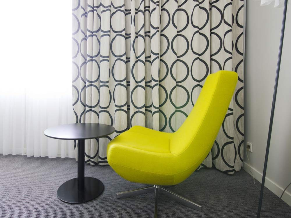 Yellow hotel chair in room