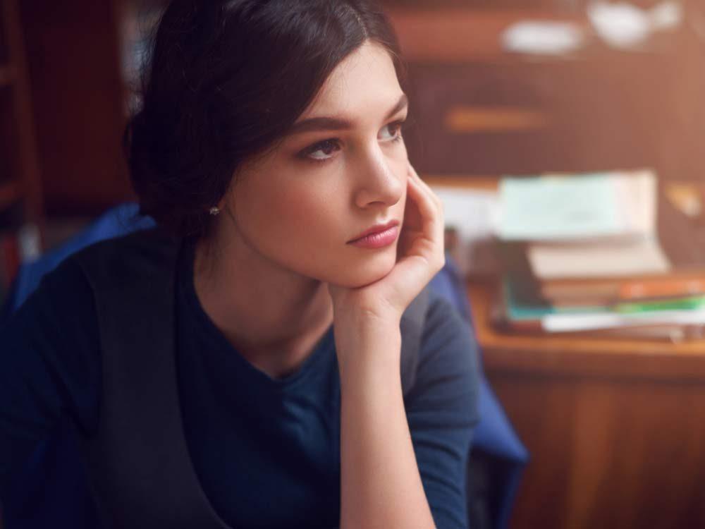 Woman thinking intently