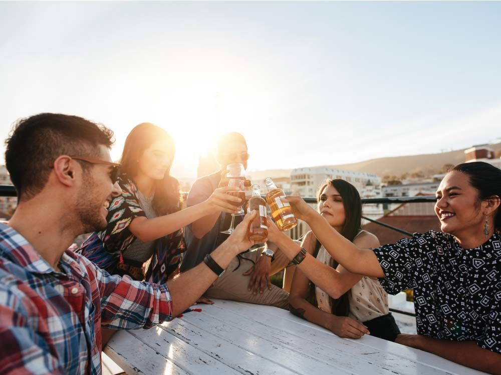 Diverse group of friends drinking on rooftop