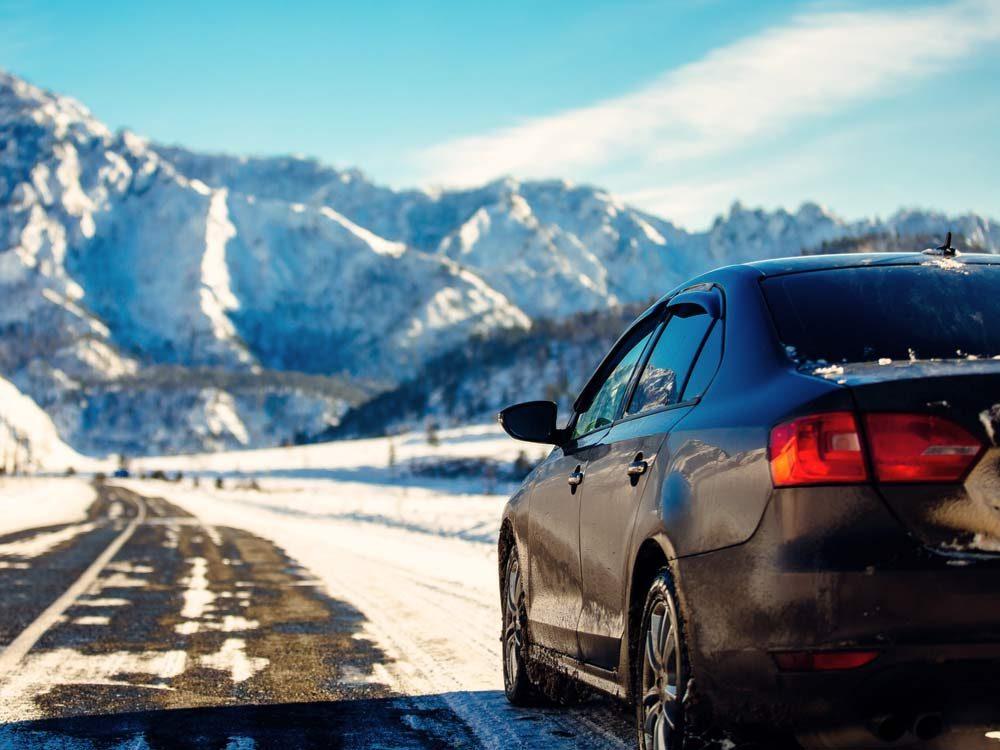 Winter road condition near mountain range