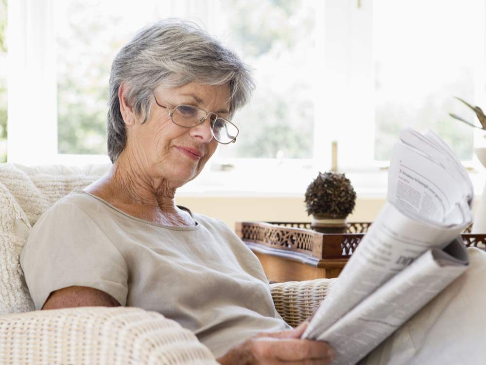 Senior woman reading a newspaper