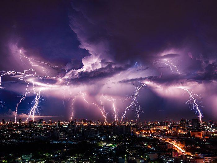 Lightning facts - Lightning storm over city in purple light