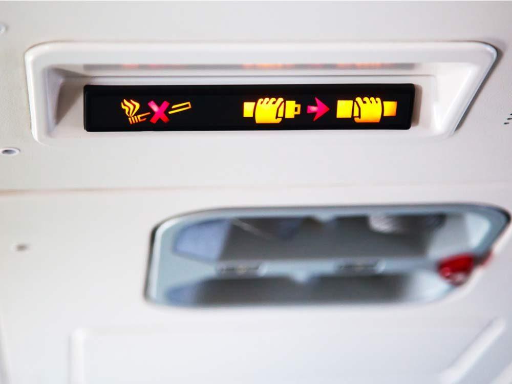 Seatbelt icon on airplane