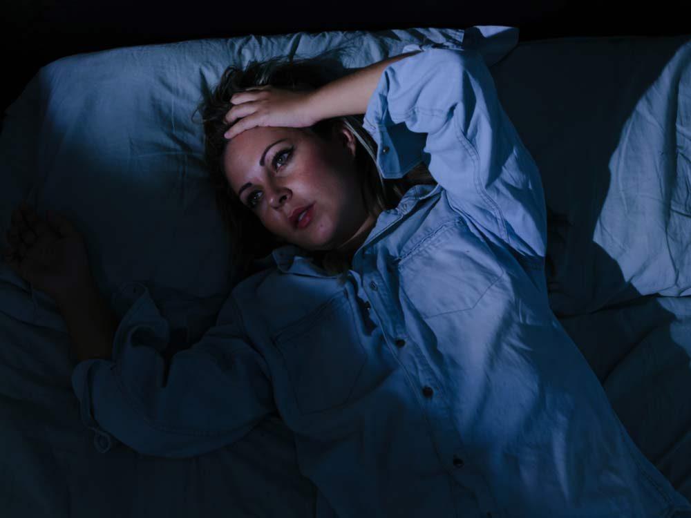 Woman experiencing interrupted sleep