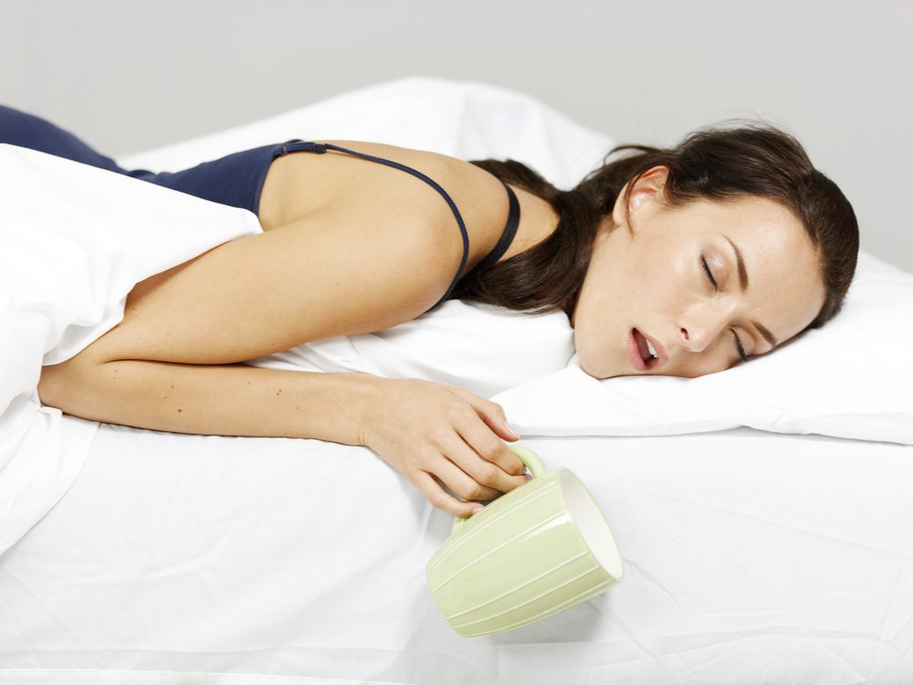 Woman suffering form lack of sleep in bed
