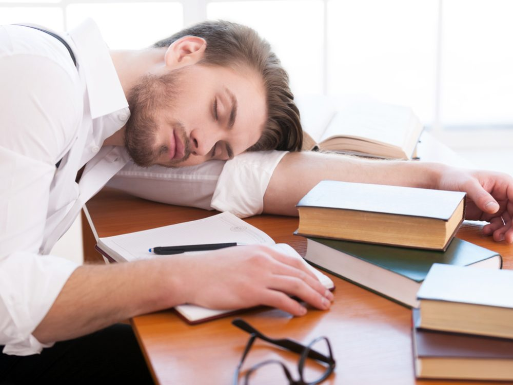 Man suffering from lack of sleep at desk