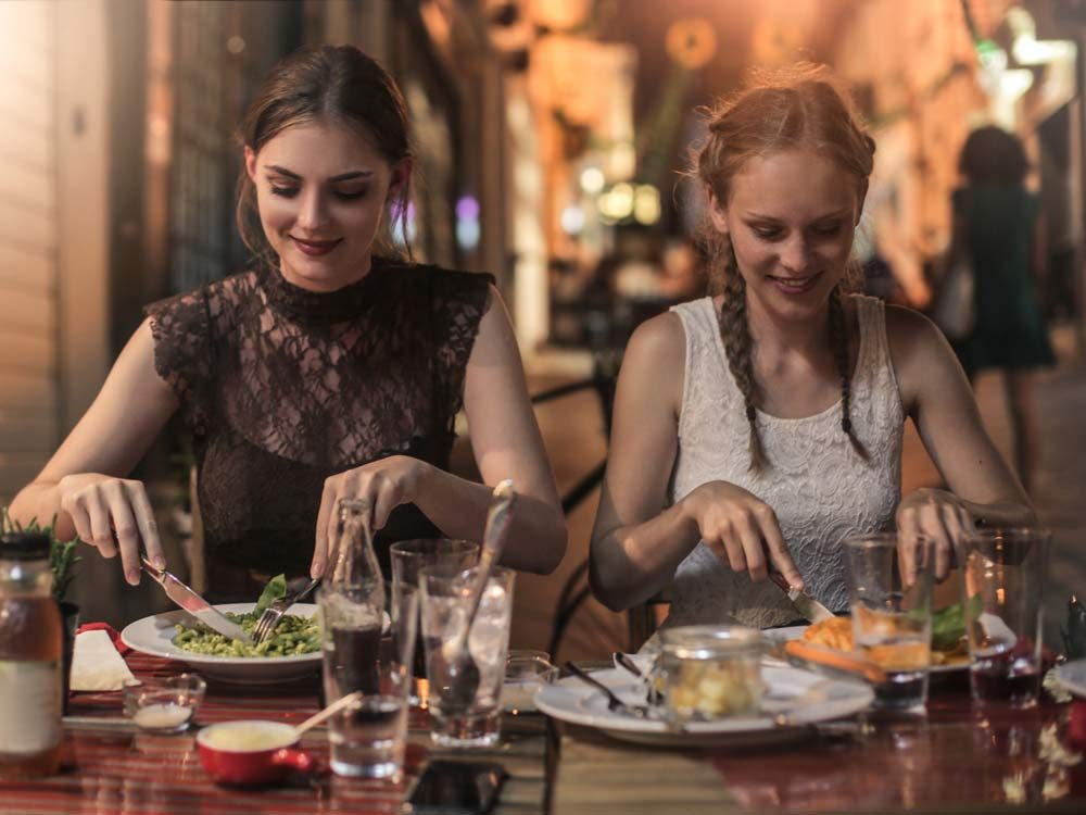 Young ladies dining in Italy