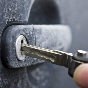 Car door lock covered in ice