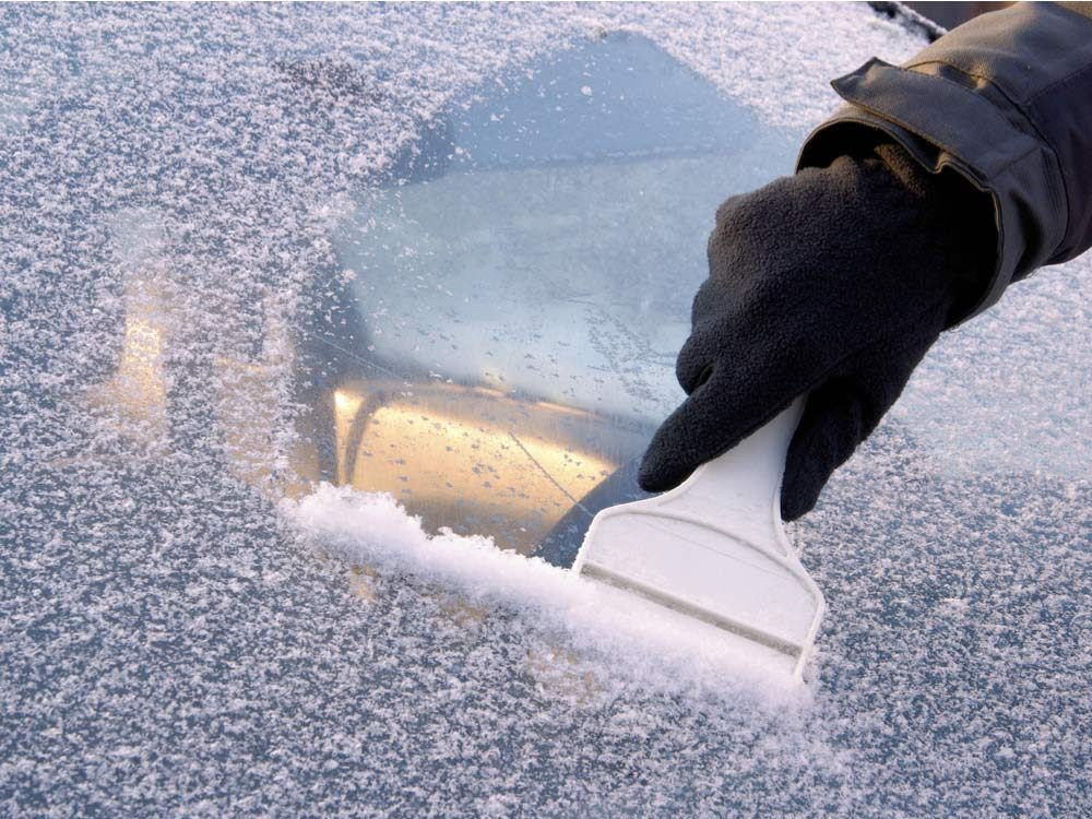 Scraping frost of windshield