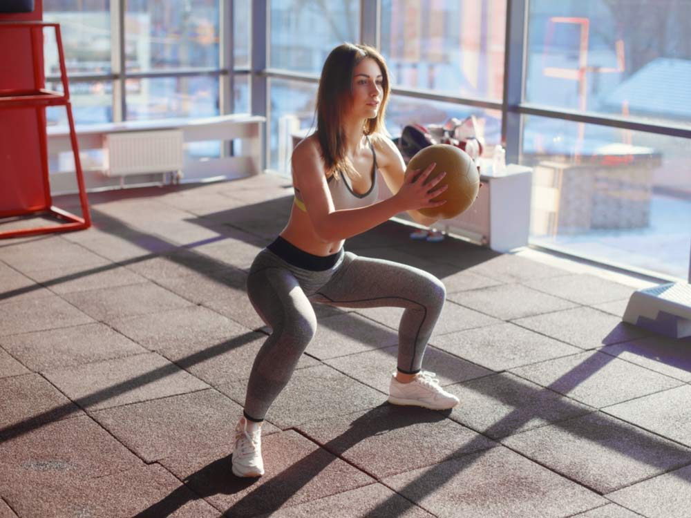 Woman showing how to squat correctly