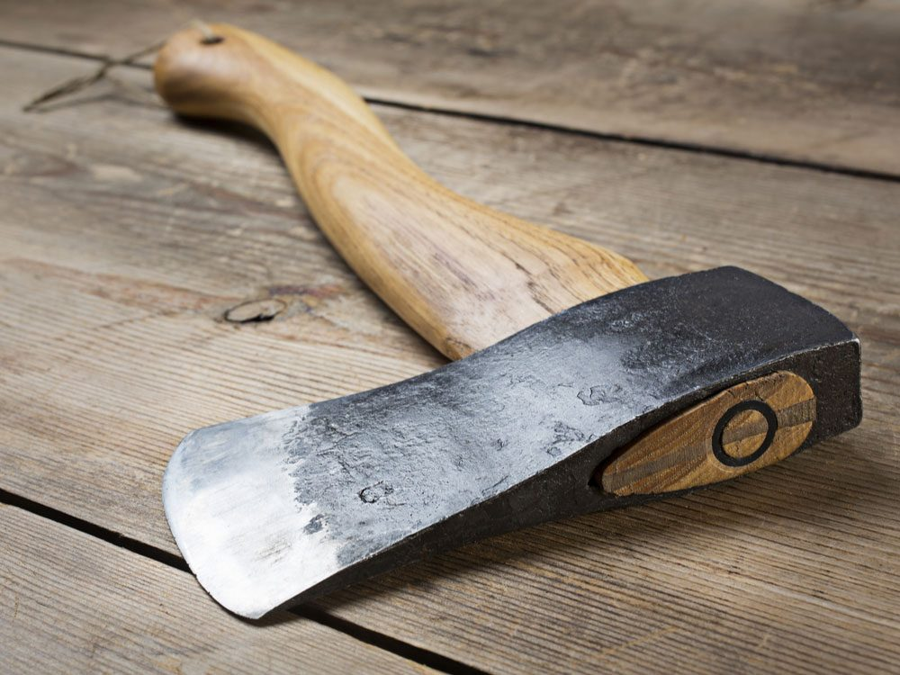Wooden axe on tabletop