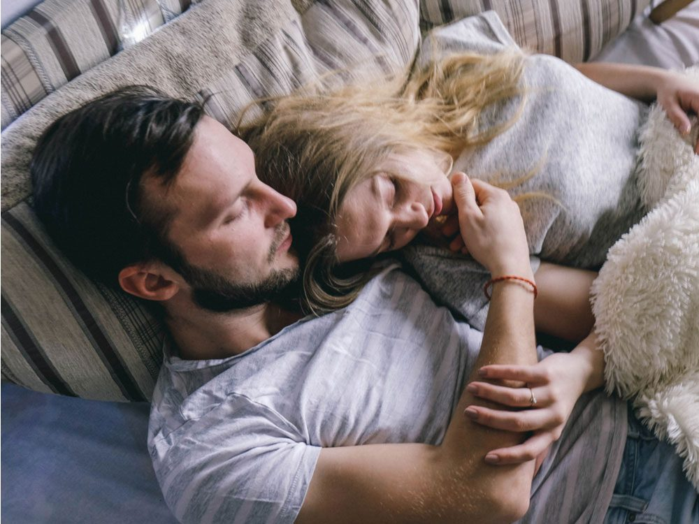 Young couple about to sleep