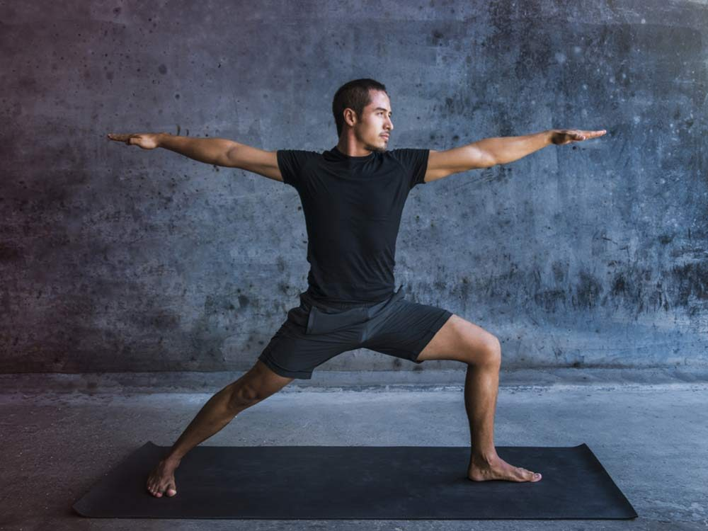 Man practicing advanced yoga
