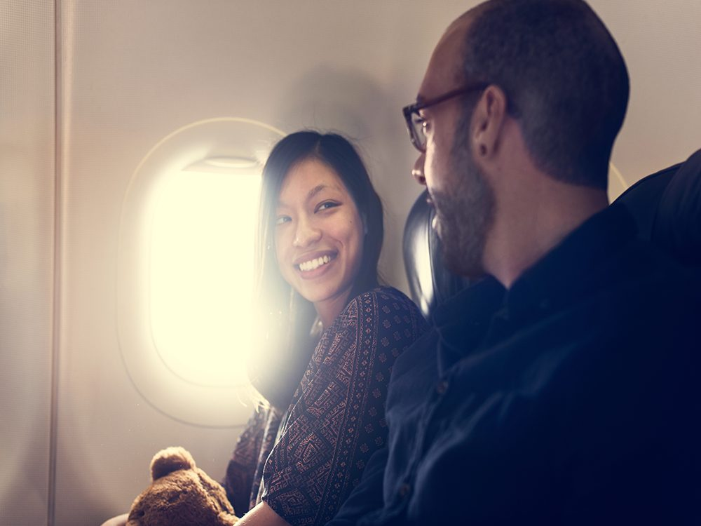 Two friends chatting on flight