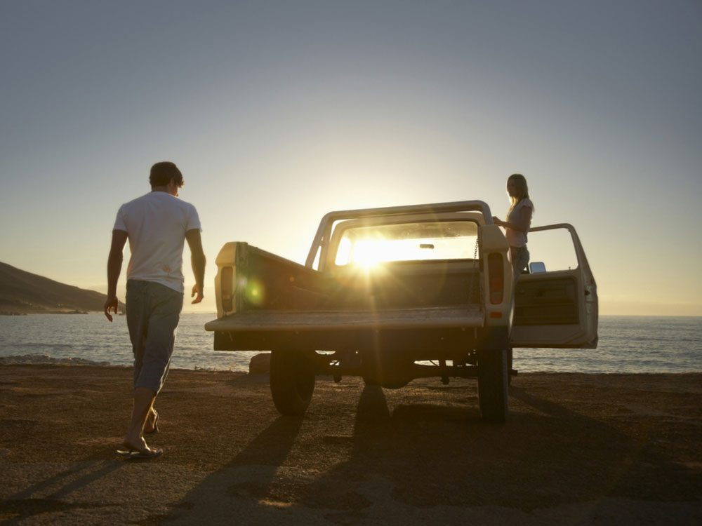 Pick-up truck at beach