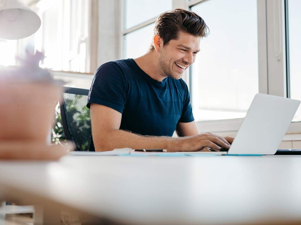 Enthusiastic man working on laptop