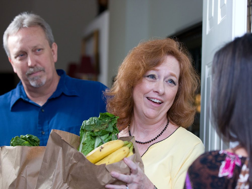 Woman bringing food to family