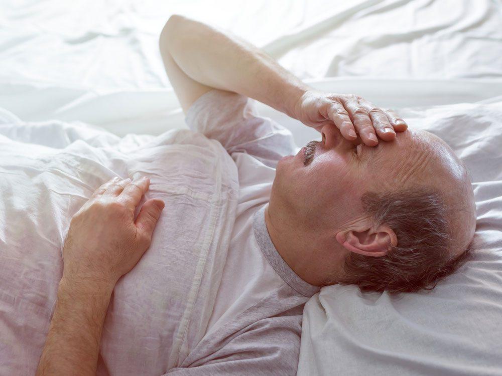 Elderly man sleeping in bed