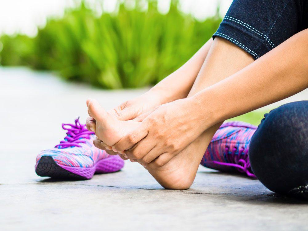 Female runner with sore feet