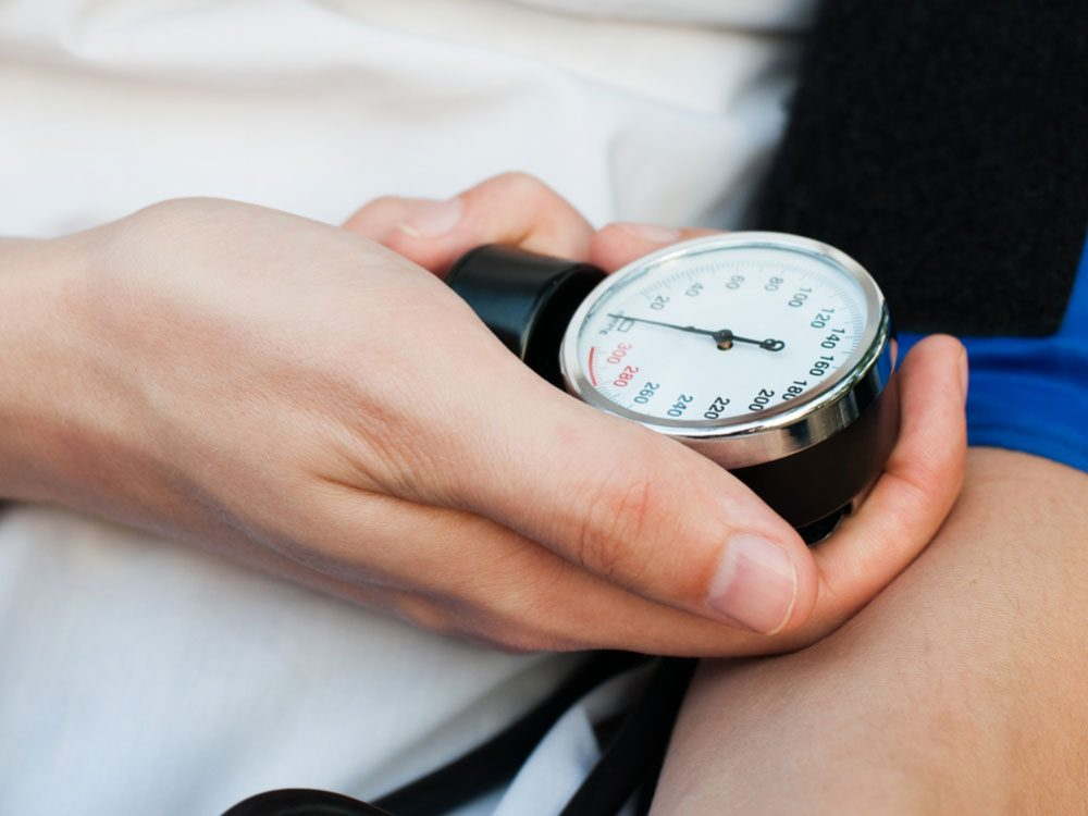 Medical practitioner checking blood pressure of patient