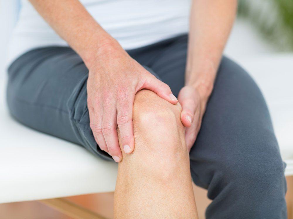 Elderly woman experiencing knee pain