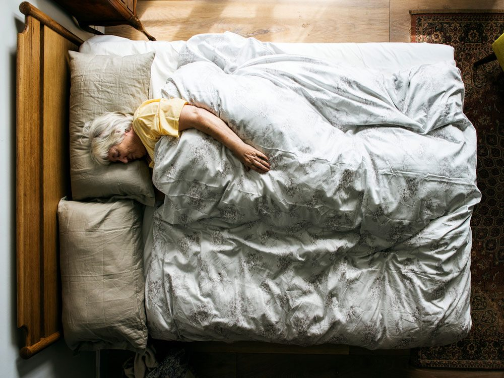 Senior woman napping during the day