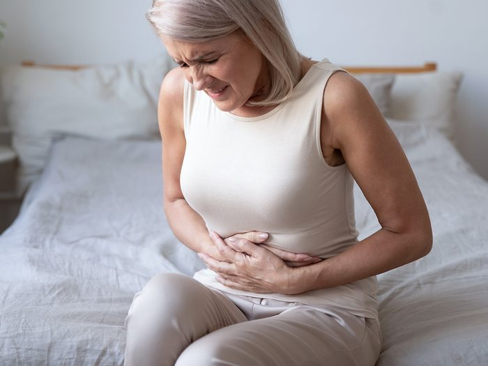 What causes gallstones - mature woman with stomach pain