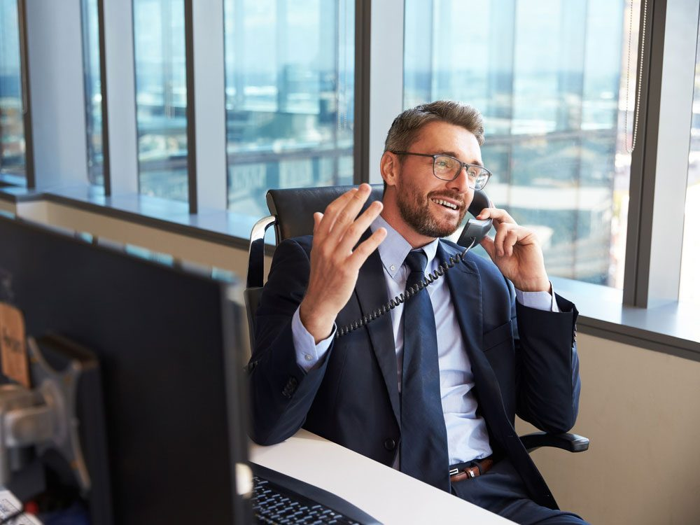 Businessman at desk talking on the phone