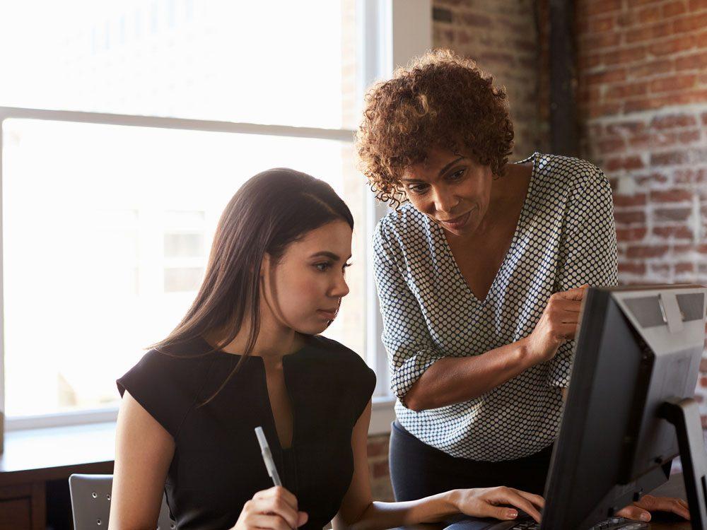 Female boss instructing employee