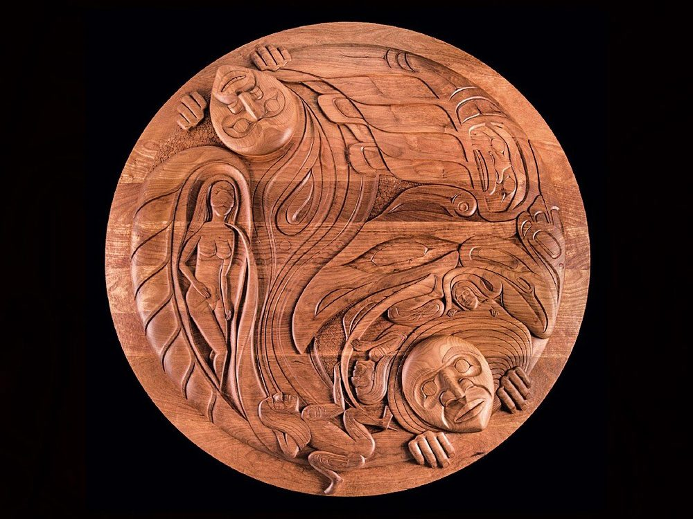 Humanity, a wood carving